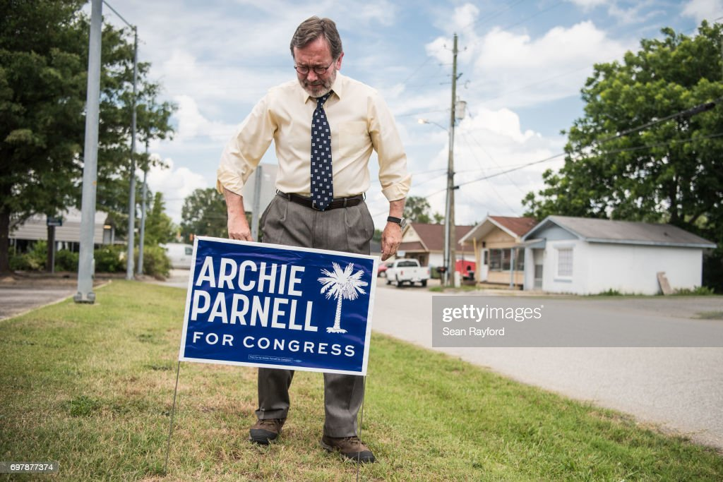 Democratic congressional candidate Archie Parnell places a campaign sign in the grass June 19, 2017 in Bishopville, South Carolina. Voters will choose between Parnell and Republican candidate Ralph Norman tomorrow in a special election for South Carolina's 5th Congressional District House seat.