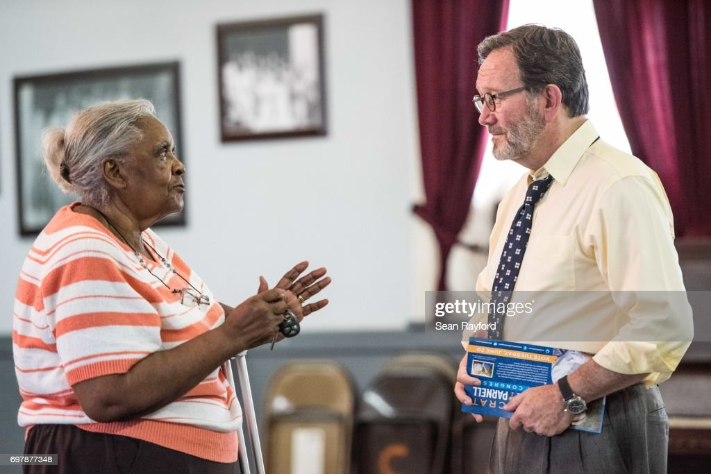 Democratic congressional candidate Archie Parnell (R) talks with Bettie Toney June 19, 2017 in Bishopville, South Carolina. Voters will choose between Parnell and Republican candidate Ralph Norman tomorrow in a special election for South Carolina's 5th Congressional District House seat.