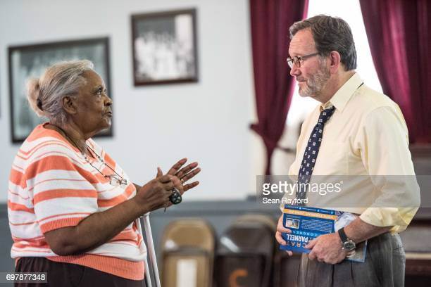 Democratic congressional candidate Archie Parnell talks with Bettie Toney June 19 2017 in Bishopville South Carolina Voters will choose between...