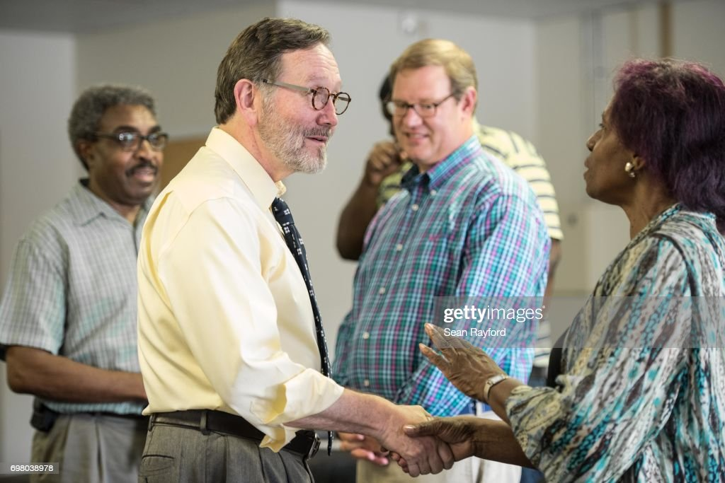 Democratic congressional candidate Archie Parnell talks with Gertie Bradshaw (R) inside the Lee County Democratic campaign offices June 19, 2017 in Bishopville, South Carolina. Voters will choose between Parnell and Republican candidate Ralph Norman tomorrow in a special election for South Carolina's 5th Congressional District House seat.