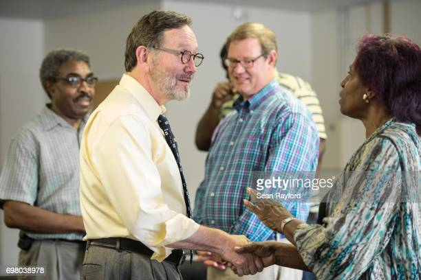Democratic congressional candidate Archie Parnell talks with Gertie Bradshaw inside the Lee County Democratic campaign offices June 19 2017 in...