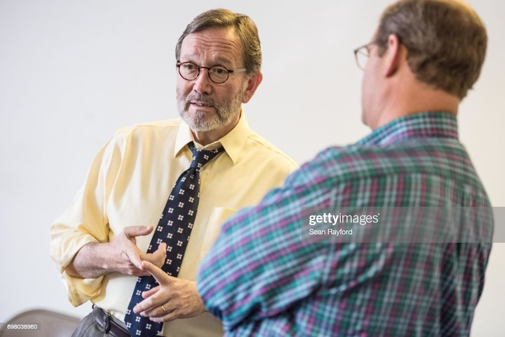 Democratic congressional candidate Archie Parnell (L) talks with U.S. Rep. Will Wheeler (D-SC) on June 19, 2017 in Bishopville, South Carolina. Voters will choose between Parnell and Republican candidate Ralph Norman tomorrow in a special election for South Carolina's 5th Congressional District House seat.