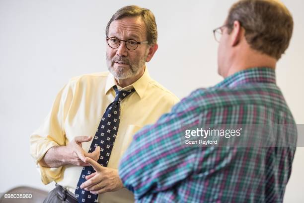 Democratic congressional candidate Archie Parnell talks with US Rep Will Wheeler on June 19 2017 in Bishopville South Carolina Voters will choose...