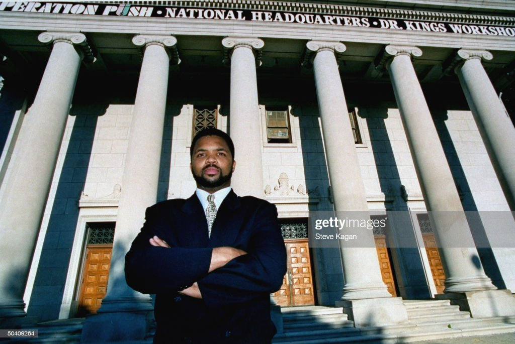 Democratic congressional candidate Jesse Jackson Jr.posing in front of Operation Push natl. HQ, his father Jesse Jackson's civil rights org.