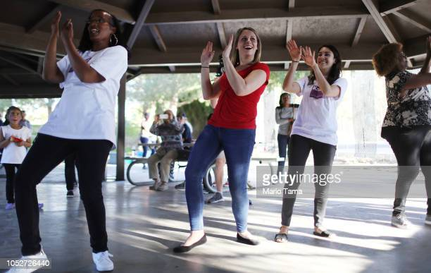 Democratic congressional candidate Katie Hill C dances at a campaign Halloween carnival event on October 21 2018 in Lancaster California Hill is...