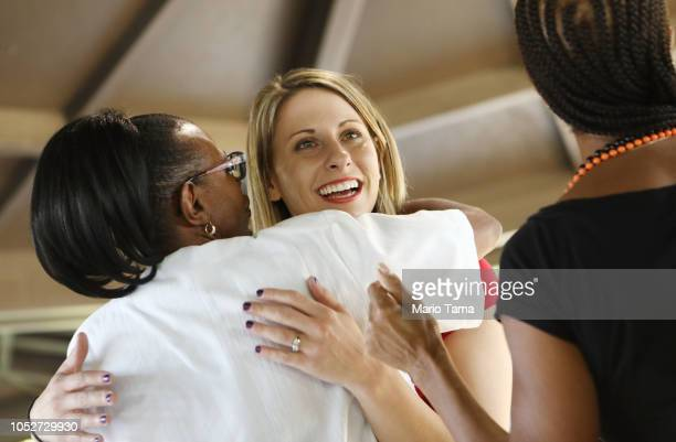 Democratic congressional candidate Katie Hill C hugs a supporter at a Halloween carnival on October 21 2018 in Lancaster California Hill is competing...