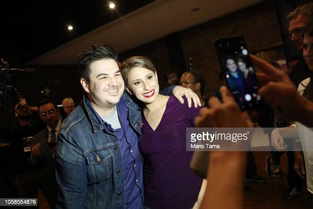 Democratic Congressional candidate Katie Hill poses for a photo with a supporter at her election night party in California's 25th Congressional...