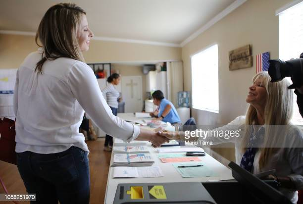 Democratic Congressional candidate Katie Hill shakes hands with a poll worker after casting her ballot at a polling place in California's 25th...