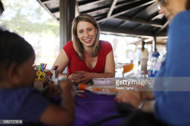 Democratic congressional candidate Katie Hill smiles while meeting supporters at a campaign Halloween carnival on October 21 2018 in Lancaster...