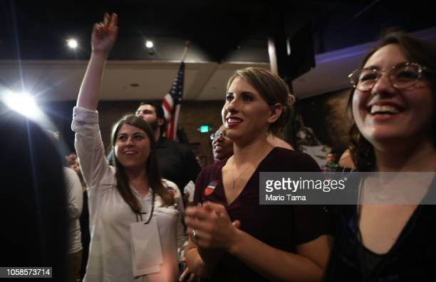 Democratic Congressional candidate Katie Hill watches television election results with supporters at her election night party in California's 25th...
