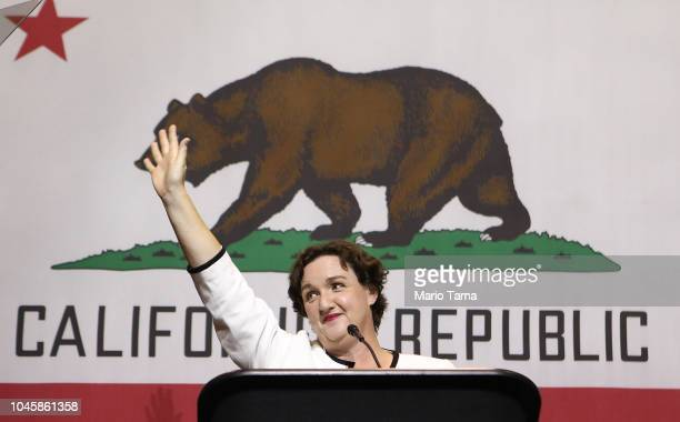 Democratic congressional candidate Katie Porter waves at a 2018 midterm elections rally on October 4 2018 in Fullerton California The event at...