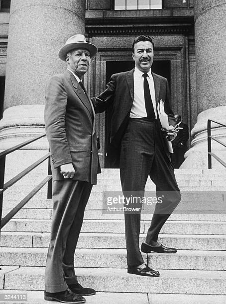 Democratic congressman Adam Clayton Powell Jr stands on a set of steps with A Philip Randolph president of the Brotherhood of Sleeping Car Porters...