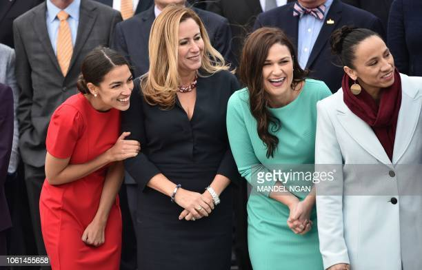 Democratic congresswomenelect Alexandria OcasioCortez Debbie MucarselPowell Abby Finkenauer and Sharice Davids pose for the 116th Congress...