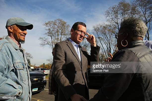 Democratic Connecticut Governor Dan Malloy speaks with voters at a polling station on November 4 2014 in Bridgeport Connecticut Around the country...