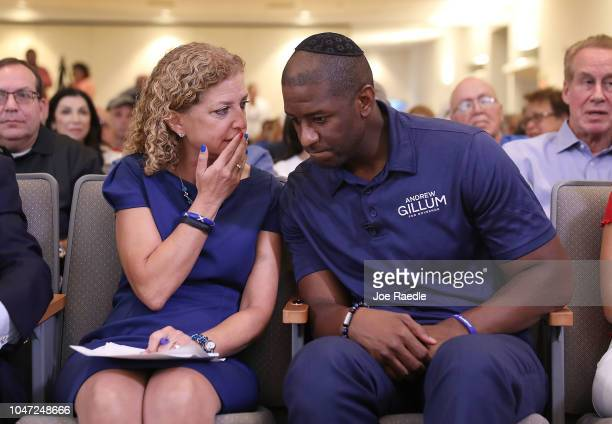 Democratic Florida gubernatorial nominee Andrew Gillum speaks with US Rep Debbie Wasserman Schultz as they attend a political event at the Century...
