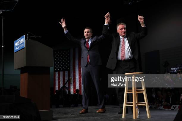 Democratic gubernatorial candidate and Virginia Lieutenant Governor Ralph Northam holds hands with Virginia Governor Terry McAuliffe during a...