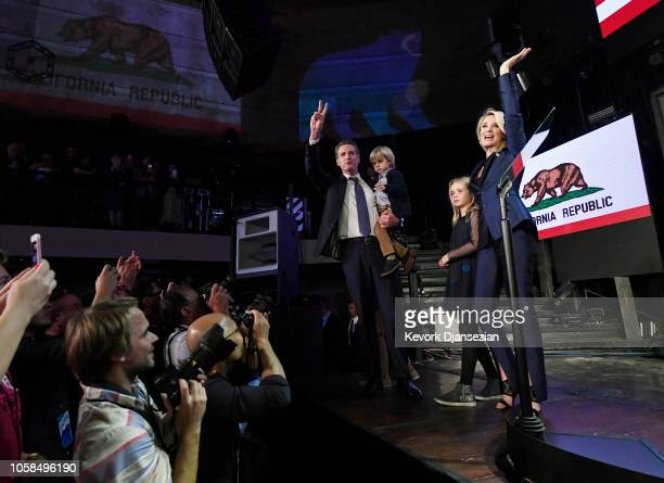 Democratic gubernatorial candidate Gavin Newsom holding his son Dutch and standing with his wife Jennifer Siebel Newsom and daughter Montana as he...