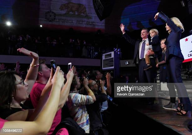 Democratic gubernatorial candidate Gavin Newsom holding his son Dutch and standing with his son Hunter wife Jennifer Siebel Newsom and daughter...
