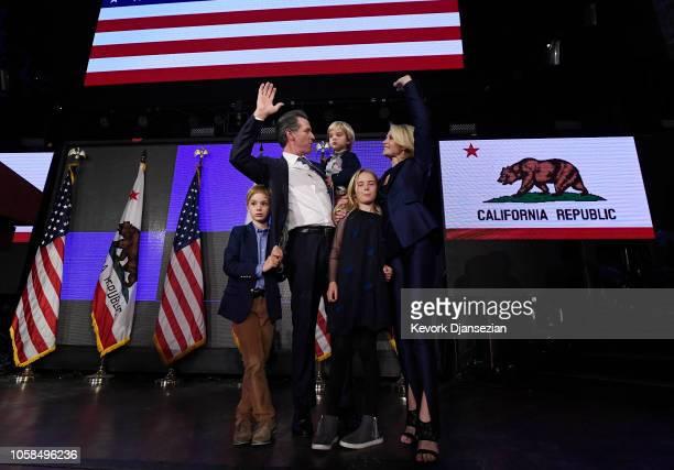 Democratic gubernatorial candidate Gavin Newsom holding his son Dutch and standing with son Hunter wife Jennifer Siebel Newsom and daughter Montana...