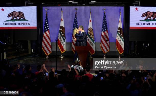 Democratic gubernatorial candidate Gavin Newsom kisses his wife Jennifer Siebel Newsom during election night event on November 6 2018 in Los Angeles...