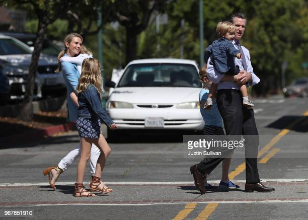 Democratic gubernatorial candidate Lt Gov Gavin Newsom and his wife Jennifer Siebel Newsom walk with their kids before voting at the Masonic Temple...