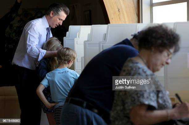 Democratic gubernatorial candidate Lt Gov Gavin Newsom fills out his ballot with his kids Hunter and Montana at the Masonic temple Fairfax on June 5...