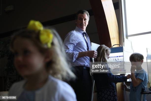 Democratic gubernatorial candidate Lt Gov Gavin Newsom fills out his ballot with his kids Hunter and Montana and Brooklyn at the Masonic temple...