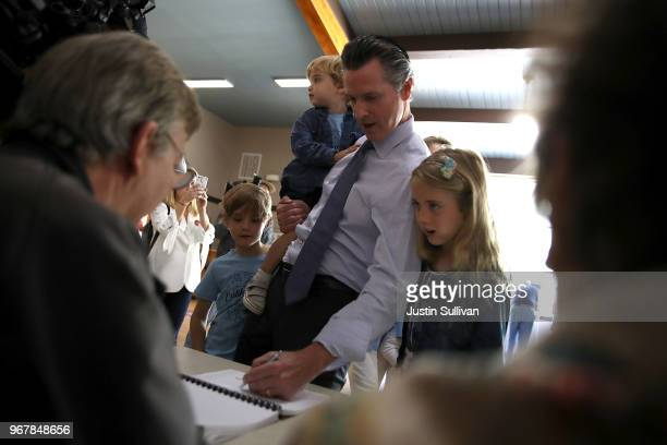 Democratic gubernatorial candidate Lt Gov Gavin Newsom preapres to fill out his ballot with his kids Hunter Dutch and Montana at the Masonic temple...