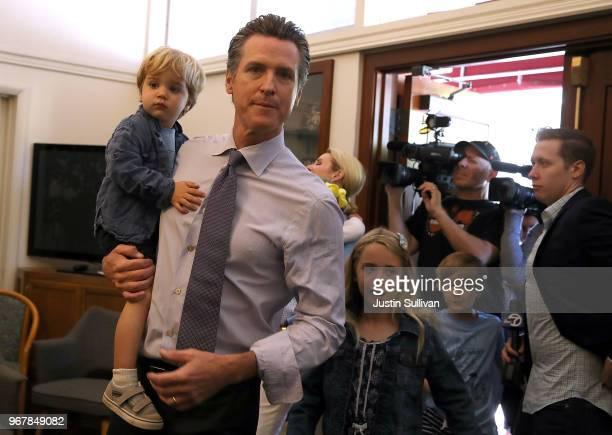 Democratic gubernatorial candidate Lt Gov Gavin Newsom walks with his kids Dutch Montana and Hunter before voting at the Masonic Temple Fairfax on...
