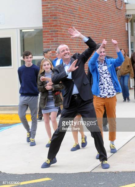 Democratic gubernatorial candidate Phil Murphy and his family acknowlege wellwishers after voting on election day November 7 2017 in Asbury Park New...
