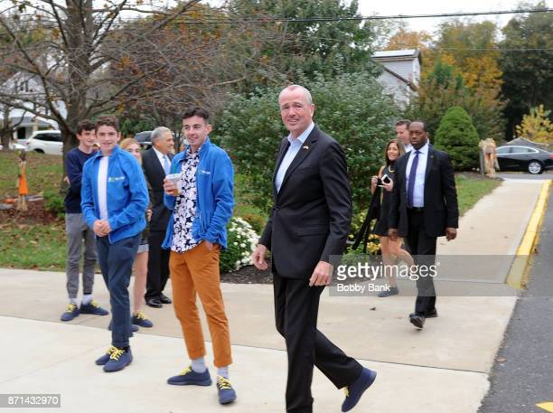 Democratic gubernatorial candidate Phil Murphy and his family arrive to vote on election day November 7 2017 in Asbury Park New Jersey Murphy and...