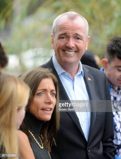 Democratic gubernatorial candidate Phil Murphy attends a news conference with his wife Tammy Murphy after voting on election day November 7 2017 in...