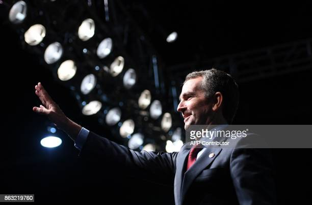 Democratic Gubernatorial Candidate Ralph Northam waves as he arrives to speak during a campaign rally in Richmond, Virginia on October 19, 2017. /...