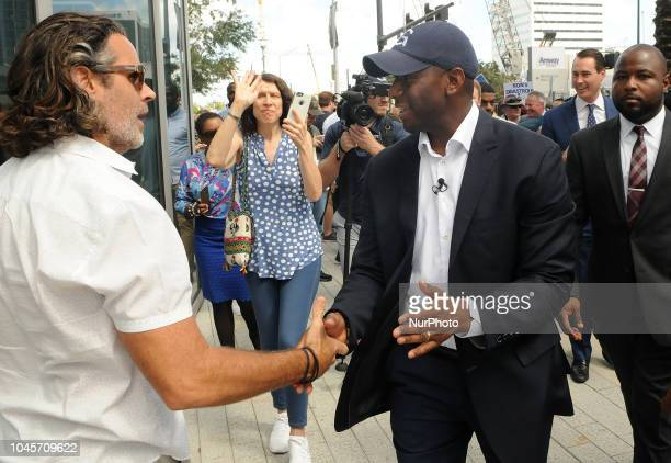 Democratic gubernatorial nominee Andrew Gillum greets supporters following a campaign event on October 4 2018 beside Interstate 4 in downtown Orlando...