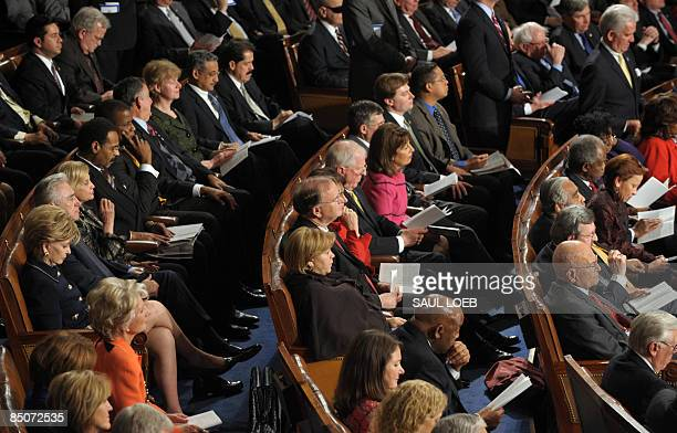 Democratic lawmakers listen as US President Barack Obama addresses a Joint Session of Congress at the Capitol in Washington on February 24, 2009. AFP...