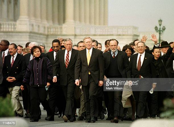 Democratic Leader Richard Gephardt walks with a large group of Democrats after marching out of the House chamber briefly to protest the Republicans''...