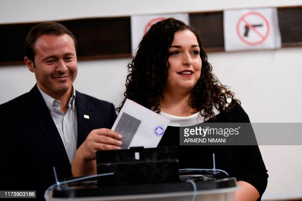 Democratic League of Kosovo opposition party's parliamentary elections candidate for Prime Minister, Vjosa Osmani, casts her ballot at a polling...