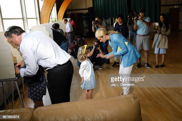 Democratic Lt Gov Gavin Newsom marks his ballot with daughter Montana while his wife Jennifer Siebel Newsom tries to occupy daughter Brooklynn at the...