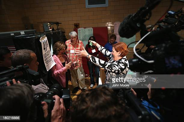 Democratic mayoral candidate Christine Quinn and her wife Kim Catullo embrace after casting their votes in the primary election for New York City...