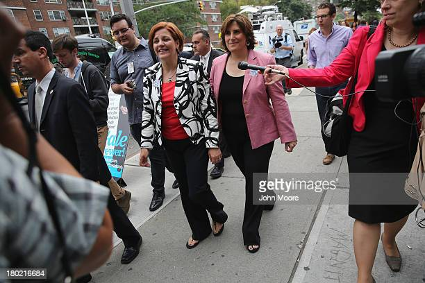 Democratic mayoral candidate Christine Quinn and her wife Kim Catullo depart a polling station after casting their votes in the primary election for...