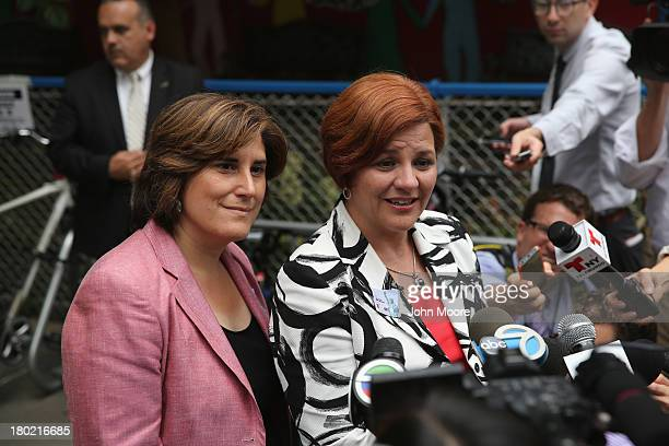 Democratic mayoral candidate Christine Quinn and her wife Kim Catullo speak to the media after casting their votes in the primary election for New...