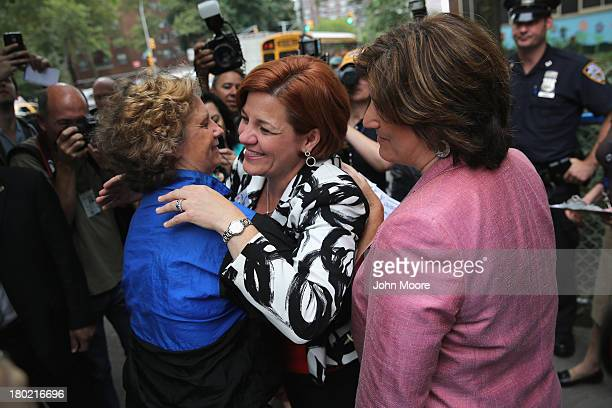 Democratic mayoral candidate Christine Quinn embraces a friend after casting her vote in the primary election for New York City mayor on September 10...