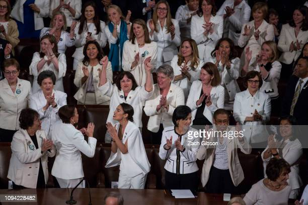 Democratic members of the House of Representatives applaud as President Donald Trump delivers the State of the Union address in the chamber of the US...