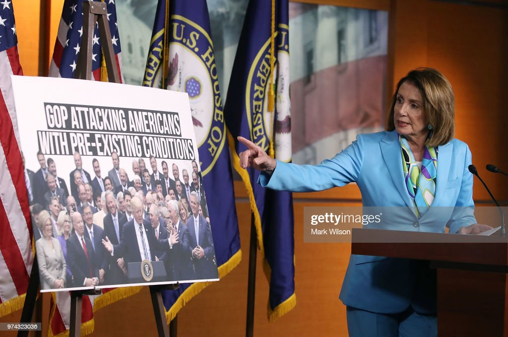 Democratic Minority Leader Nancy Pelosi (D-CA) speaks about health care as she points to a picture of President Trump with House GOP members, during her weekly press conference on Capitol Hill, June 14, 2018 in Washington, DC.