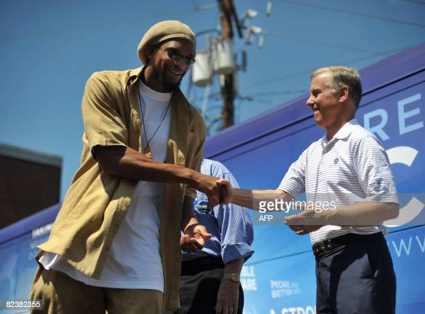 Democratic National Committee Chairman Howard Dean shakes hands with Etan Thomas of the Washington Wizards August 16 2008 during a voter registration...