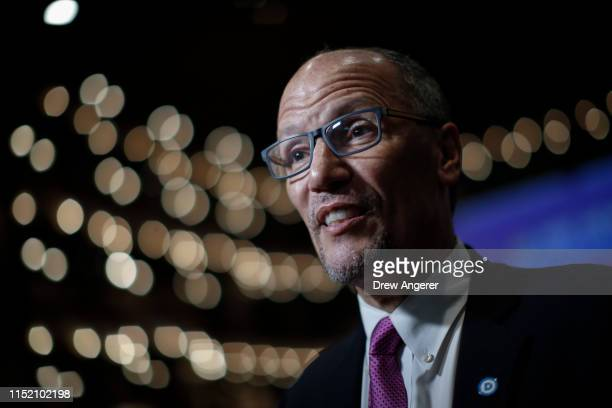 Democratic National Committee chairman Tom Perez speaks to reporters in the spin room ahead of the first Democratic presidential primary debate for...
