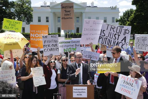 Democratic National Party Chirman Tom Perez speaks as about 300 people rally to protest against President Donald Trump's firing of Federal Bureau of...