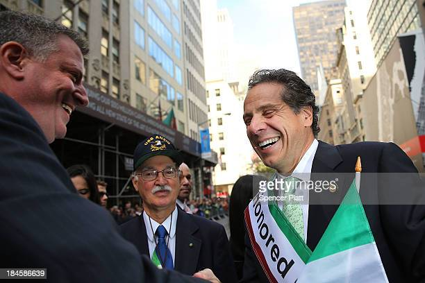 Democratic New York City mayoral candidate Bill de Blasio speaks with New York Governor Andrew Cuomo while marching in the 69th Annual Columbus Day...
