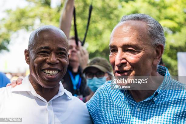"""Democratic New York City mayoral nominee Eric Adams and Senate Majority Leader Chuck Schumer attend the Ticker Tape Parade """"Hometown Heroes"""" on July..."""