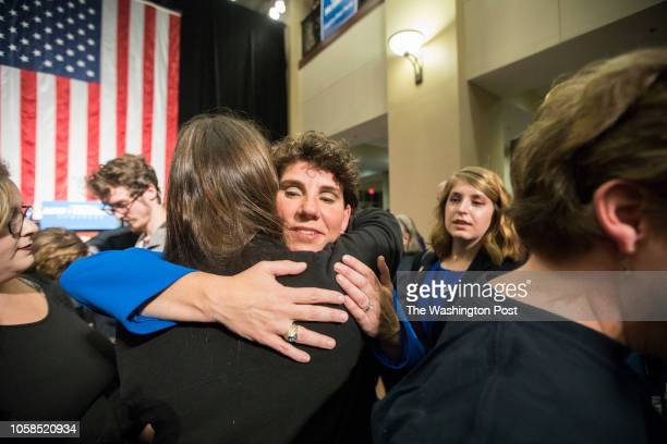 RICHMOND KENTUCKY USA NOVEMBER 6 2018 Democratic nominee Amy McGrath hugs a supporter after conceding the election for Kentuckys 6th congressional...